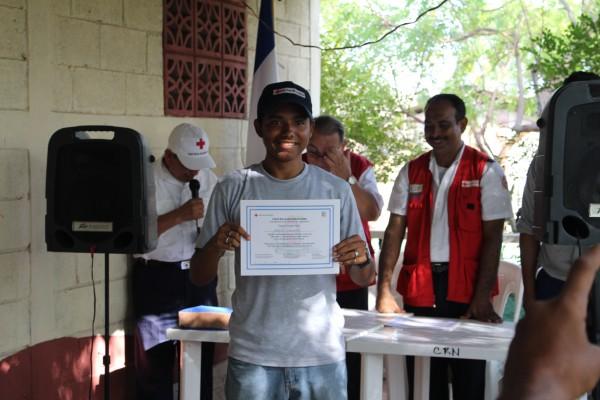 Miguel receiving an ISLA certificate.