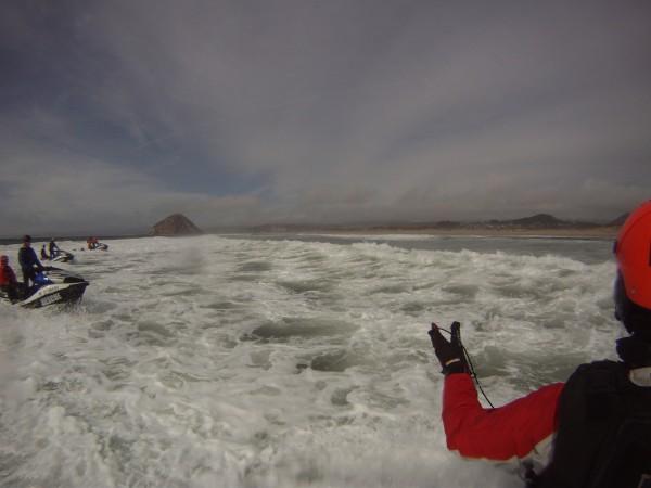 Instructor Shawn Alladio directs the echelon formation through the surfline.